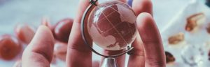 Photo of person holding a globe